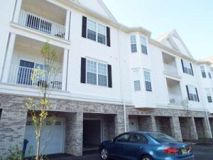 Inspected 6/10/15. 3rd floor condo with 2 car garage. Built 2012.